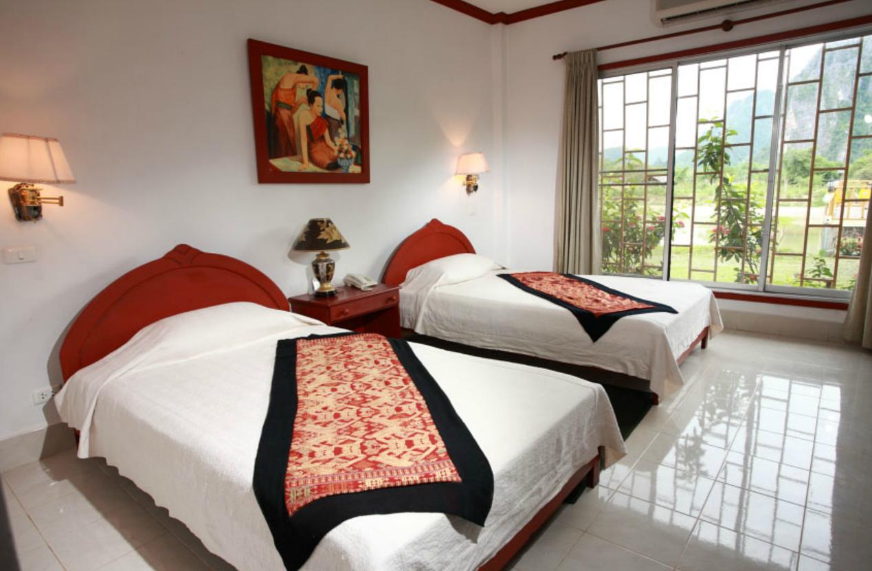 Vansana vang vieng resort laos roads for Domon guesthouse vang vieng